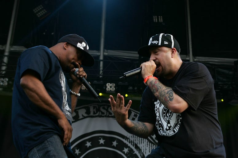 Sen Dog and B-Real of the group Cypress Hill perform on stage at the 'Rock The Bells' tour on Randall's Island on July 28, 2007 in New York City.