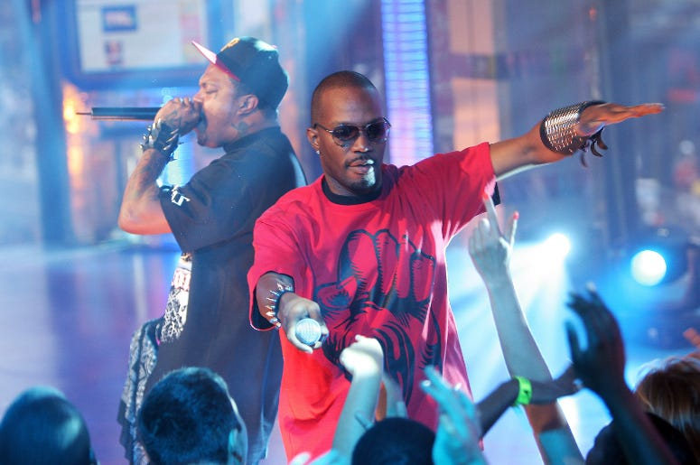 Juicy J (R) and DJ Paul of Three 6 Mafia perform onstage during MTV's Total Request Live at the MTV Times Square Studios July 1, 2008 in New York City.
