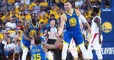 Andrew Bogut with Kevin Durant and Draymond Green