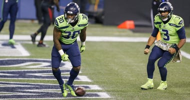 Russell Wilson and Carlos Hyde