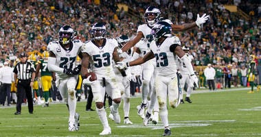 Sep 26, 2019; Green Bay, WI, USA; Philadelphia Eagles linebacker Nigel Bradham (53) celebrates after intercepting a pass during the fourth quarter against the Green Bay Packers at Lambeau Field