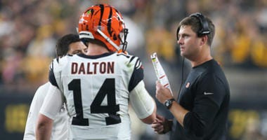 Sep 30, 2019; Pittsburgh, PA, USA; Cincinnati Bengals quarterback Andy Dalton (14) talks with head coach Zac Taylor (right) during a time out against the Pittsburgh Steelers during the second quarter at Heinz Field.