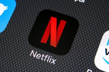 Netflix application icon on Apple iPhone X screen close-up. Netflix app icon. Netflix application. Social media network.