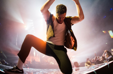 Dan Reynolds of Imagine Dragons performs live on stage at the Genting Arena in Birmingham, UK