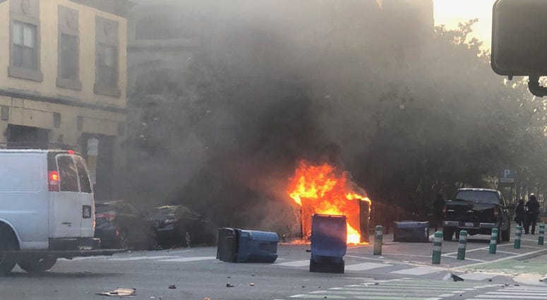 A dumpster burns at a George Floyd protest in San Jose.
