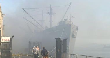 Smoke rises over the SS Jeremiah O'Brien at Pier 45 at San Francisco's Fisherman's Wharf.