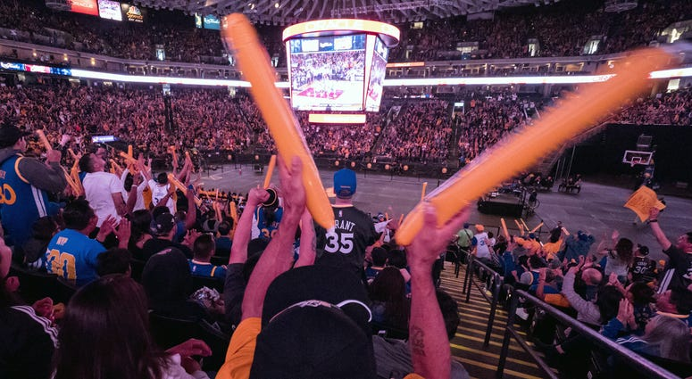 A Golden State Warriors fan waves thunder sticks during a watch party for game four of the 2017 NBA Finals against the Cleveland Cavaliers at Oracle Arena. Mandatory Credit: Kelley L Cox-USA TODAY Sports