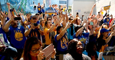 Jun 15, 2017; Oakland, CA, USA; Fans cheer during the Golden State Warriors 2017 championship victory parade in downtown Oakland. Mandatory Credit: Cary Edmondson-USA TODAY Sports