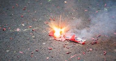 Firecracker exploding in the street