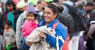 April 29, 2018; San Ysidro, CA, USA; Migrants arrive at the U.S./Mexico entry point in Tijuana. The members of the caravan will try to seek asylum in the U.S. Mandatory Credit: Omar Ornelas/The Desert Sun via USA TODAY NETWORK