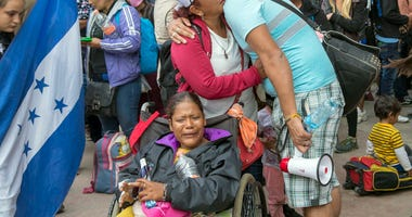 April 29, 2018; Tijuana, Baja California, MEXICO; Part of the Central American migrant caravan group crossing Tijuana bridge. Some broke down crying just outside the entrance to the U.S. port at San Ysidro in Tijuana, on April 29, 2018. These migrants wil