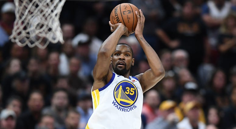 Jun 6, 2018; Cleveland, OH, USA; Golden State Warriors forward Kevin Durant (35) shoots against the Cleveland Cavaliers during the second quarter in game three of the 2018 NBA Finals at Quicken Loans Arena. Mandatory Credit: Ken Blaze-USA TODAY Sports