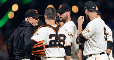 Jun 18, 2018; San Francisco, CA, USA; San Francisco Giants pitching coach Curt Young (left) talks to relief pitcher Hunter Strickland (60) and catcher Buster Posey (28) before the pitch against the Miami Marlins in the ninth inning at AT&T Park.