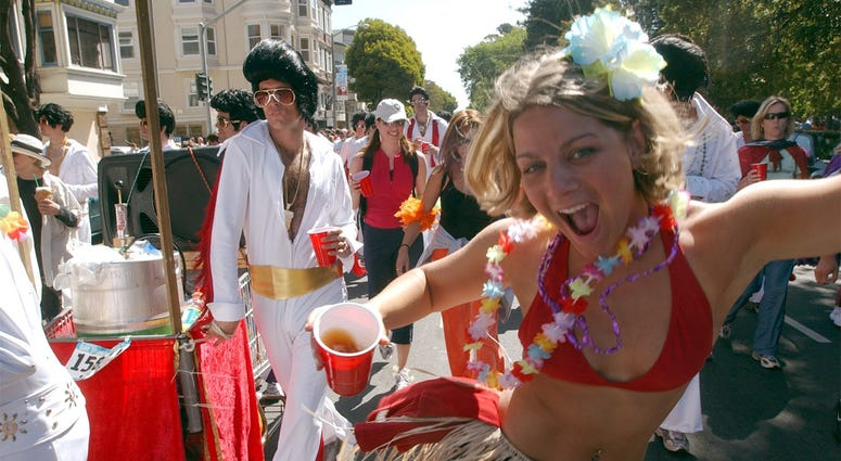 SAN FRANCISCO, CA -- A group dressed as Elvis and other runners make their way down Fell Street during the Bay to Breakers race in San Francisco, California, on May 16, 2004. (Photo by cdm) 2004