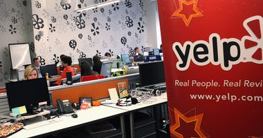 Employees of the online review site Yelp watch as New York City Mayor Michael Bloomberg speaks at the new East Coast headquarters of the tech company on October 26, 2011 in New York City. The Bloomberg administration has been heralding and working to faci