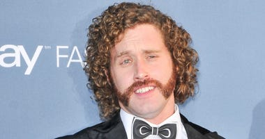 TJ Miller and (not shown) Kate Gorney at the 22nd Annual Critics' Choice Awards held at Barker Hanger in Santa Monica, CA on December 11, 2016.