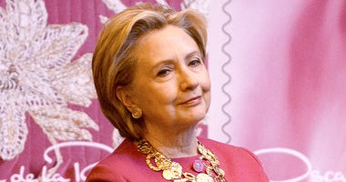 Former US Secretary of State and Democratic presidential nominee Hillary Clinton attends the unveiling ceremony for the U.S. Postal Service Oscar de la Renta Forever stamp, at Grand Central Terminal in New York, NY, on February 16, 2017.. A black and whit