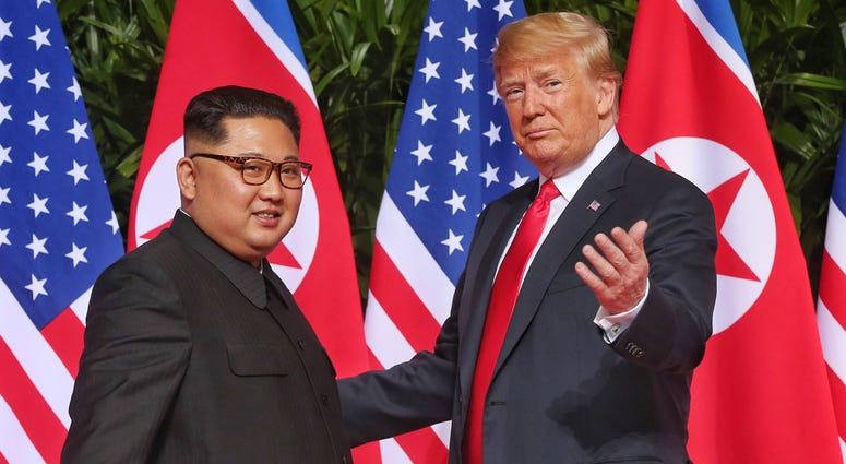 SINGAPORE, June 12, 2018 (Xinhua) -- Top leader of the Democratic People's Republic of Korea (DPRK) Kim Jong Un (L) meets with U.S. President Donald Trump in Singapore, on June 12, 2018. (Xinhua/The Straits Times) (zcc) (Photo by Xinhua/Sipa USA)