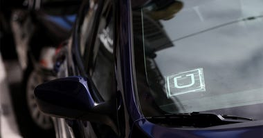 SAN FRANCISCO, CA - JUNE 12: A sticker with the Uber logo is displayed in the window of a car on June 12, 2014 in San Francisco, California. The California Public Utilities Commission is cracking down on ride sharing companies like Lyft, Uber and Sidecar
