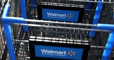 SAN LORENZO, CA - FEBRUARY 20: Walmart shopping carts sit outside of a store on February 20, 2014 in San Lorenzo, California. Wal-Mart reporterd a 21 percent