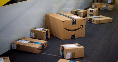 ROBBINSVILLE, NJ - AUGUST 1: Boxes travel on conveyor belts at the Amazon Fulfillment Center on August 1, 2017 in Robbinsville, New Jersey. The more than 1 million square feet facility holds tens of millions of products, features more than 14 miles of con