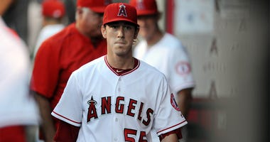July 29, 2016; Anaheim, CA, USA; Los Angeles Angels starting pitcher Tim Lincecum (55) returns to the dugout following the top of the first inning against Boston Red Sox at Angel Stadium of Anaheim. Mandatory Credit: Gary A. Vasquez-USA TODAY Sports