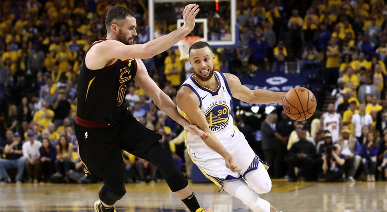 OAKLAND, CA - MAY 31: Stephen Curry #30 of the Golden State Warriors drives to the basket defended by Kevin Love #0 of the Cleveland Cavaliers in Game 1 of the 2018 NBA Finals at ORACLE Arena on May 31, 2018 in Oakland, California.