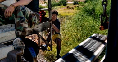 Oct 25, 2016; Sonora, Mexcio; A Honduran migrant jumps aboard a moving freight train in Mexico headed toward the U.S. border south of Caborca, Sonora. There are many cases of migrants who have lost legs after falling off the freight trains, known as La Be