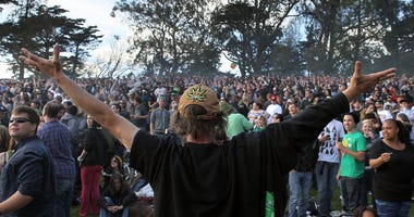 SAN FRANCISCO - APRIL 20: A cloud of smoke rests over the heads of a group of people during a 420 Day celebration on 'Hippie Hill' in Golden Gate Park April 20, 2010 in San Francisco, California. April 20th has become a de facto holiday for marijuana advo