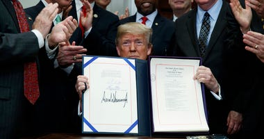 """Donald Trump shows off the """"Economic Growth, Regulatory Relief, and Consumer Protection Act."""""""