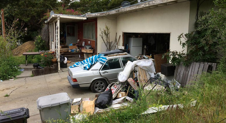 A condemned home is seen Wednesday, April 18, 2018, in Fremont, Calif. The condemned Northern California house with holes in the roof and mildew in the pipes sold last month for $1.23 million.