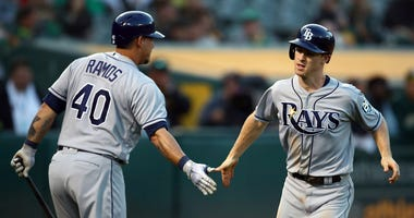 ampa Bay Rays' Joey Wendle, right, is congratulated by Wilson Ramos