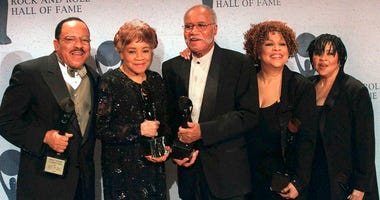 FILE - This March 15, 1999 file photo shows the sibling group The Staples Singers, from left, Pervis, Cleotha, Pops, Mavis, and Yvonne at the Rock and Roll Hall of Fame induction ceremony in New York. Yvonne Staples, whose voice and business acumen powere