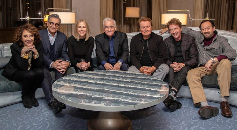 """This undated image released by Netflix shows director Martin Scorsese, center, with the cast of the Canadian sketch comedy show """"SCTV,"""" from left, Andrea Martin, Eugene Levy, Catherine O'Hara, Dave Thomas, Martin Short and Joe Flaherty. Netflix announced"""