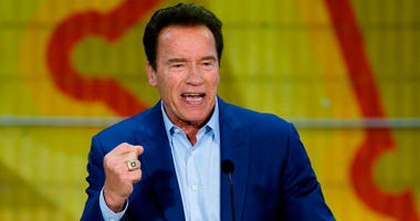 FILE - In this March 21, 2018 file photo, former California Gov. Arnold Schwarzenegger speaks at the first New Way California Summit, a political committee eager to reshape the state GOP, at the Hollenbeck Youth Center in Los Angeles. Schwarzenegger says