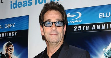 "FILE - In this Monday, Oct. 25, 2010 file photo, musician Huey Lewis attends the ""Back To The Future"" 25th anniversary reunion in New York. In a statement released Friday, April 13, 2018, Huey Lewis and The News announced the cancellation of its 2018 tour"