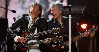 Richie Sambora, left, and Jon Bon Jovi perform during the Rock and Roll Hall of Fame induction ceremony, Saturday, April 14, 2018, in Cleveland. (AP Photo/David Richard)