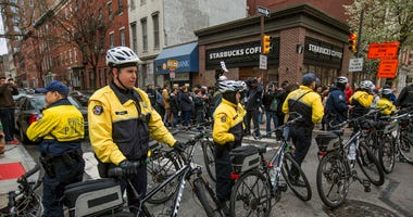 Philadelphia police form a line in front of the Starbucks that was at the center of a Black Lives Matter protest on Sunday, April 15, 2018. Two black men were arrested Thursday after Starbucks employees called police to say the men were trespassing. The a
