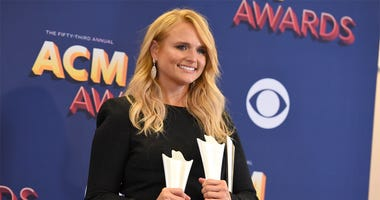 "Miranda Lambert poses in the press room with two awards for song of the year for ""Tin Man"" as performer and song writer, and for female vocalist of the year at the 53rd annual Academy of Country Music Awards at the MGM Grand Garden Arena on Sunday, April"