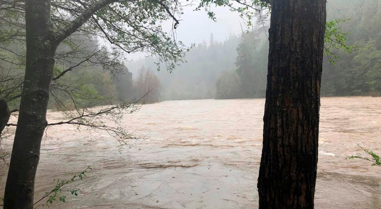 File - This photo released April 12, 2018, by The Mendocino County Sheriff's Office shows the Eel River in Northern California. Authorities searching for a family whose SUV plunged into a rain-swollen Northern California river found the vehicle and the bo