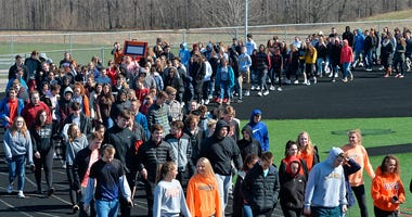 Fairview Middle and High School students taking part in a national school walkout event to protest gun violence and honor shooting victims at Fairview High School in Fairview Township, Erie County, Pa., Friday April 20, 2018. As part of the event, most of