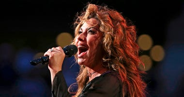 In this Aug. 28, 2017, file photo, Shania Twain performs during opening ceremonies for the U.S. Open tennis tournament in New York. Twain has apologized for saying if she were American she would have voted for Donald Trump for president, even though he's