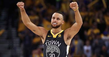 Golden State Warriors' Stephen Curry (30) celebrates a score against the New Orleans Pelicans during the second half in Game 2 of a second-round NBA basketball playoff series Tuesday, May 1, 2018, in Oakland, Calif. (AP Photo/Ben Margot)