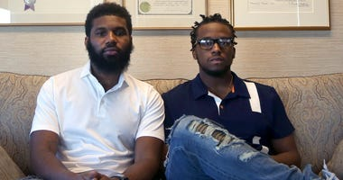 In this April 18, 2018, file photo, Rashon Nelson, left, and Donte Robinson, right, both 23, pose for a portrait following an interview with The Associated Press in Philadelphia. The two black men, arrested for sitting at a Starbucks cafe in Philadelphia