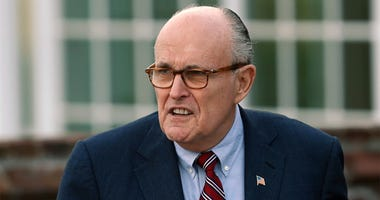 In this Nov. 20, 2016 file photo, former New York Mayor Rudy Giuliani arrives at the Trump National Golf Club Bedminster clubhouse in Bedminster, N.J. President Donald Trump's new lawyer Rudy Giuliani said Wednesday, May 2, 2018, the president repaid atto