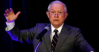 Attorney General Jeff Sessions speaks at the Association of State Criminal Investigative Agencies event Monday, May 7, 2018, in Scottsdale, Ariz. Sessions says the Department of Homeland Security has agreed to refer anyone who enters the United States ill