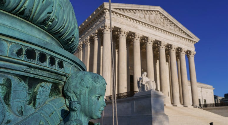 The Supreme Court is seen in Washington, April 20, 2018. The Supreme Court says employers can prohibit their workers from banding together to complain about pay and conditions in the workplace. (AP Photo/J. Scott Applewhite)