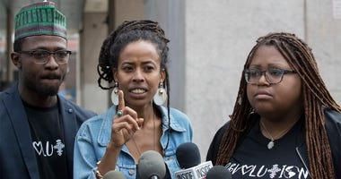 Donisha Prendergast, center, is joined by Kelly Fyffe Marshall, right, and Komi-Oluwa Olafimihan as she speaks during a news conference, Thursday, May 10, 2018, in New York. Prendergast, the granddaughter of Bob Marley, and her two friends say they want p