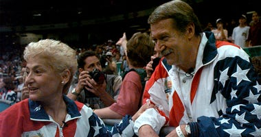 In this July 23, 2004, file photo, Martha and Bela Karolyi watch together as the U.S. womens gymnastic team celebrates winning the gold medal at the Centennial Summer Olympic Games in Atlanta. Victims of disgraced sports doctor Larry Nassar are imploring