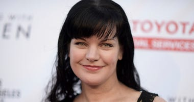 """In this May 21, 2016 file photo, Pauley Perrette attends """"An Evening with Women"""" held at the Hollywood Palladium in Los Angeles. Perrette says CBS has always been good to her and has always had her back, days after she said she suffered """"multiple physical"""